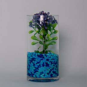 Berry Pick Decorated with Ocean Blue Stones in a Glass Vase