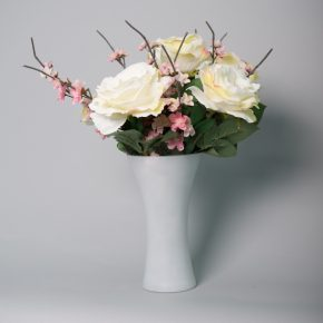 White Roses Blushed in Pink with Cherry Blossoms in a Tall White Frosted Vase