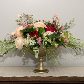 Cream Pink and Burgundy Cabbage Roses Arranged in a Champagne Glass Pedestal