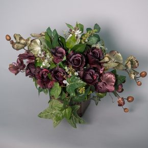 Dark Mauve Roses with Ivy and Orchid Arranged in a Brown Glass Vase