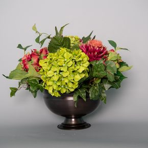Green and Plum Hydrangea with Artichoke Protea and Pineapple Succulent in an Antique Copper Bowl