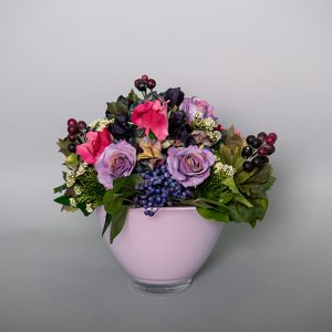 Hot Pink and Mauve Roses with Berries in a Pink Oval Bowl