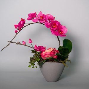 Hot Pink Orchid with Hot Pink Peony in an Oval Grey Ceramic Vase