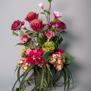 Hydrangea Succulent Pick with Artichoke Protea and Pineapple Succulent Arrangement in a Glass Brown Vase