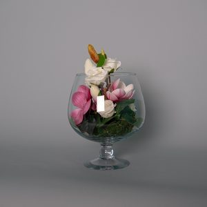 Magnolias with White Roses in a Glass Champagne Glass
