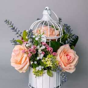 Pink Mahonia Grass, Baby Breath, Lavender and Pink Roses in a White Bird Cage