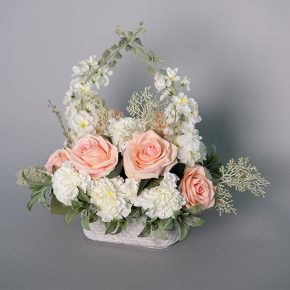Pink Roses, White Carnations and White Snap Dragons with Assorted Dusty Miller in an Oval Cement Pot