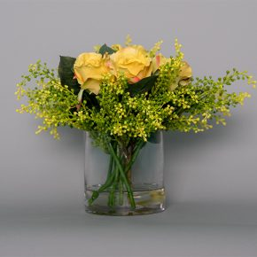 Yellow Roses with Eucalyptus Buds in a Glass Vase