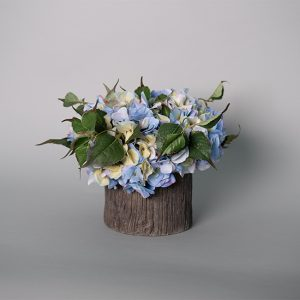 Blue Hydrangea in a Ceramic Tree Trunk Pot