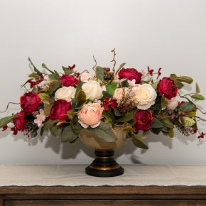 Burgundy Cabbage Roses with Rose Bush and Berries in a Metal Pedestal