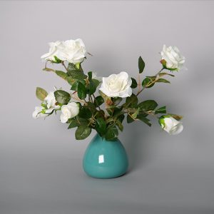 Cream Rose Spray in a Ceramic Blue Vase