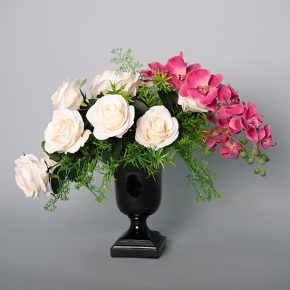 Cream Roses with Blushed Tips and Hot Pink Phalaenopsis Orchid in a Black Resin Urn