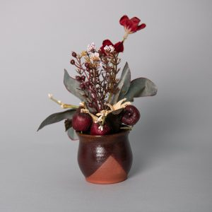 Floral and Fruit Decoration in a Handmade Amber Ceramic Pot
