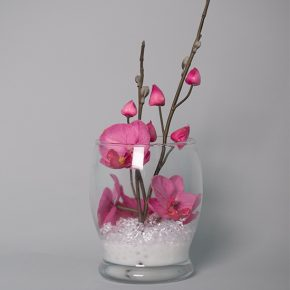 Hot Pink Orchids Decorated with White Stones in a Glass Vase