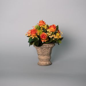 Orange Flowers and Kalanchoe Plant in an Antique Ceramic Urn