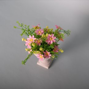 Plastic Pink Daisies in a Ceramic Urn