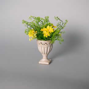 Plastic Yellow Daisies in a Ceramic Urn