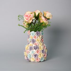 Small Pink and Cream Roses in a Multi Color Floral Ceramic Vase