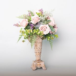dusty-roses-with-gypsophila-and-fern-in-an-antique-candle-holder-1